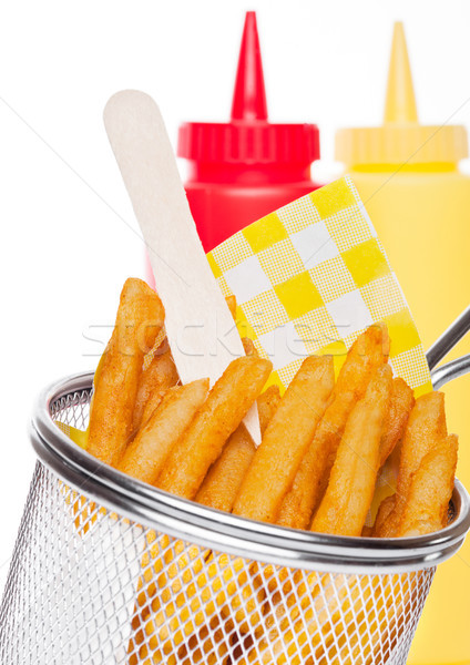 Basket of freshly made southern fries with ketchup Stock photo © DenisMArt