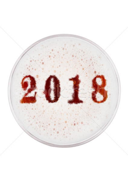 Glass of red ale beer top with 2018 year digits Stock photo © DenisMArt