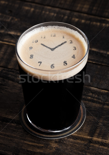 Glass of stout beer top with clock shape Stock photo © DenisMArt
