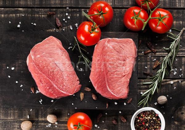 Fresh raw beef steak meat on wooden board  Stock photo © DenisMArt