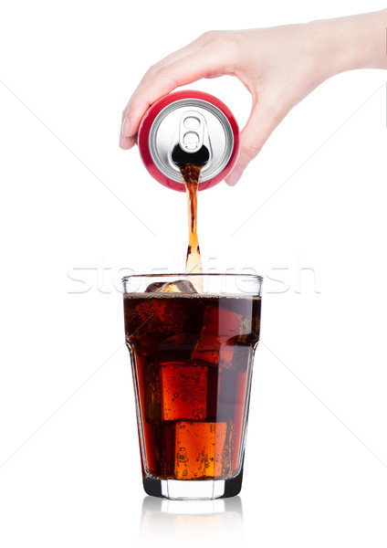 Female hand pouring cola drink from tin to glass Stock photo © DenisMArt