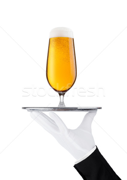 Mano guante bandeja cerveza vidrio Foto stock © DenisMArt