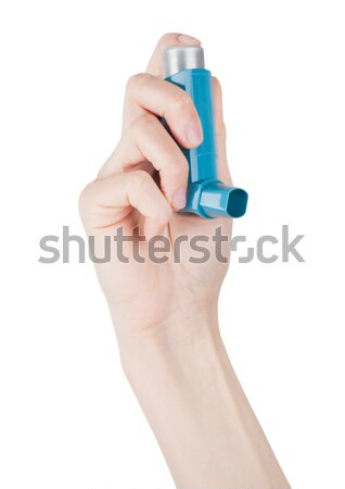 Hand holds blue asthma inhaler for relief asthma Stock photo © DenisMArt