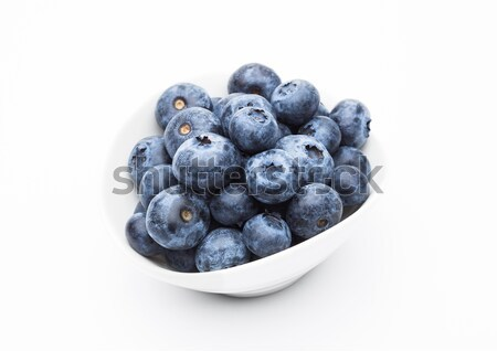 Fresh healthy organic blueberry in white bowl Stock photo © DenisMArt
