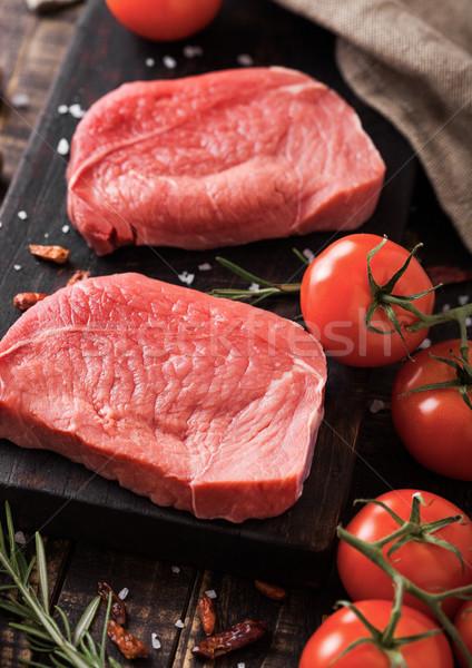 Friss nyers bifsztek hús fa deszka fából készült Stock fotó © DenisMArt