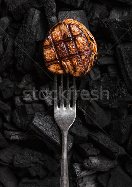 Grilled juicy beef pork steak on barbecue coil Stock photo © DenisMArt