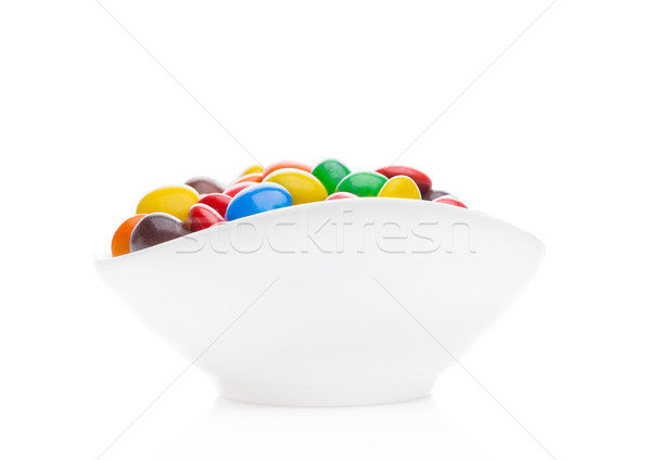 Round colorful coated sweet candies in white bowl Stock photo © DenisMArt