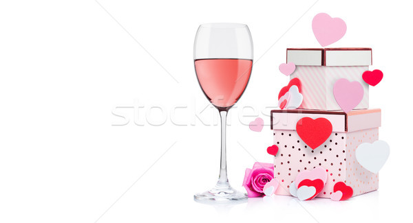 Glass of pink wine with heart and pink gift box Stock photo © DenisMArt