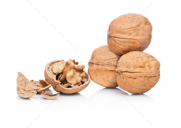 Raw walnuts with shell on white background  Stock photo © DenisMArt