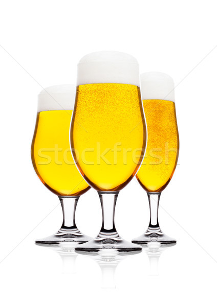Cold glasses of lager beer with foam and dew Stock photo © DenisMArt