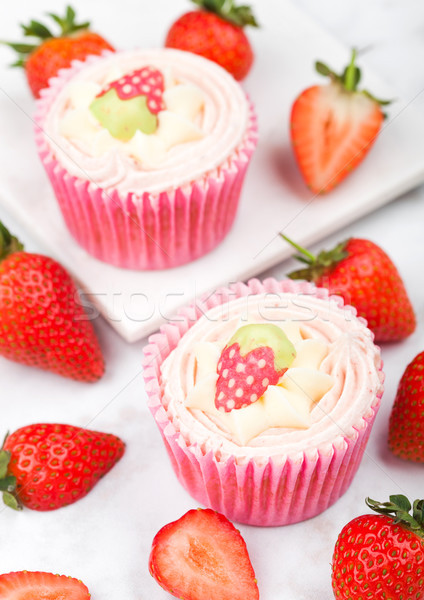 Fresh strawberry cupcake muffins with raw berries Stock photo © DenisMArt
