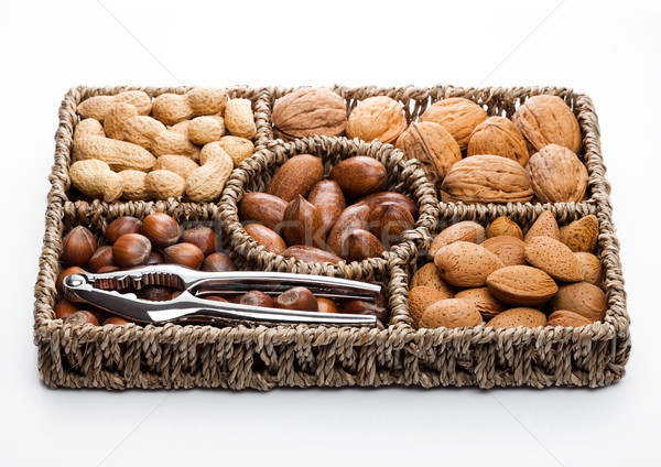 Basket reach in various kinds of nuts in shells Stock photo © DenisMArt