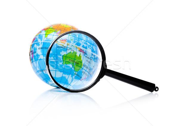 Globe under magnifying glass zooming Australia Stock photo © DenisMArt