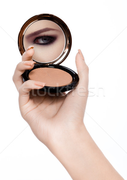 Arm holding powder foundation mirror reflection Stock photo © DenisMArt