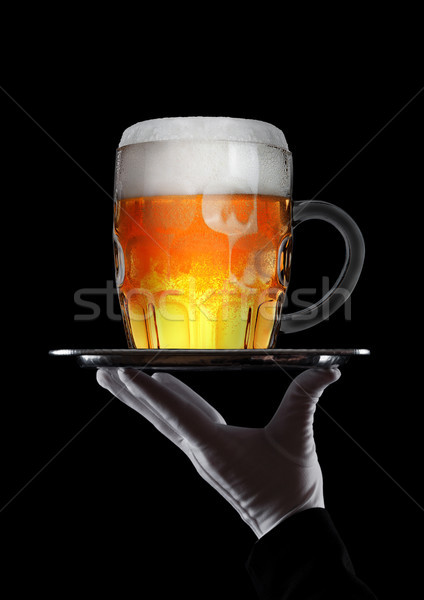 Mano guante bandeja vidrio cerveza espuma Foto stock © DenisMArt