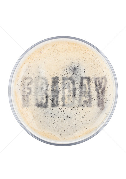 Glass of stout beer top with friday shape Stock photo © DenisMArt
