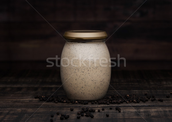 Glass jar of pepper sauce for meat on wood Stock photo © DenisMArt