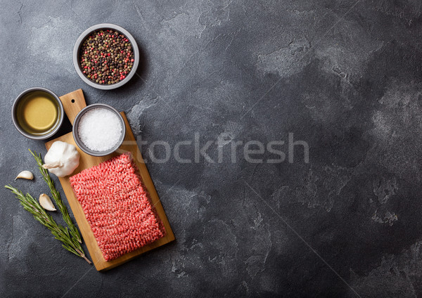 Raw minced homemade beef meat with spices and herbs. Top view and space for text.On top of chopping  Stock photo © DenisMArt