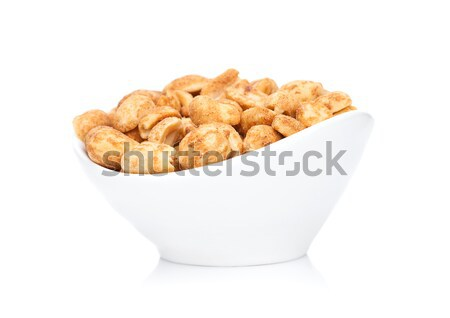 Salty peanuts snack in white bowl Stock photo © DenisMArt