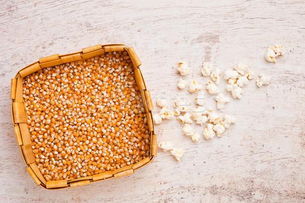 Bamboo basket with raw sweet corn and popcorn Stock photo © DenisMArt