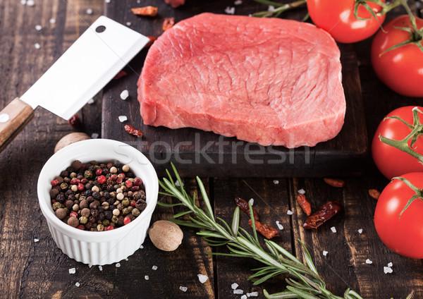 Fresh raw beef steak meat on board with hatchet Stock photo © DenisMArt