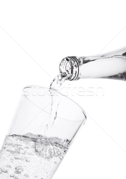 Pouring sparkling mineral water from bottle Stock photo © DenisMArt