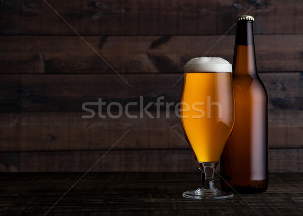 Glass and bottle of golden lager beer with foam Stock photo © DenisMArt