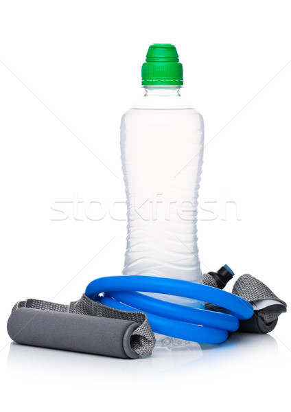 Bottle of sport energy drink with resistance band  Stock photo © DenisMArt