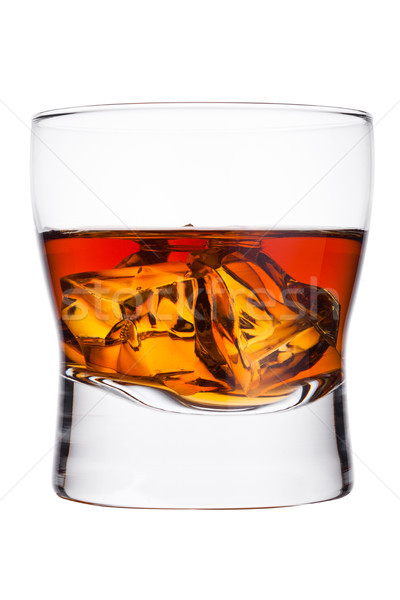 Elegant glass of whiskey with ice cubes Stock photo © DenisMArt