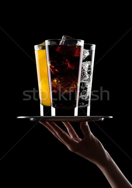 手 トレイ ガラス コーラ オレンジ 水 ストックフォト © DenisMArt