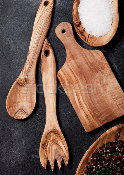 Olive wood kitchen utensils with chopping board and bowl on ston Stock photo © DenisMArt