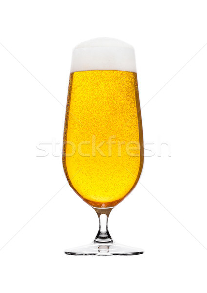 Cold glass of lager beer with foam and bubbles Stock photo © DenisMArt