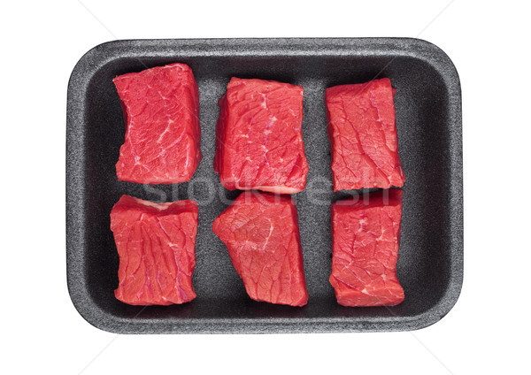 Pieces of fresh raw beef meat in plastic tray Stock photo © DenisMArt