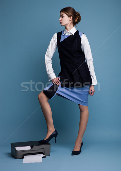 Businesswoman in working suit standing on printer  Stock photo © DenisMArt