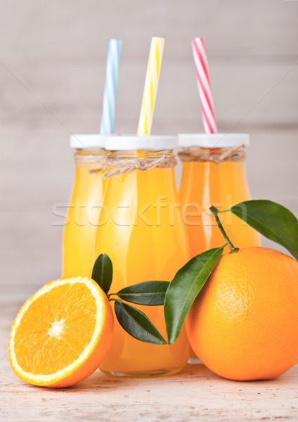 üveg üvegek nyers organikus friss narancslé Stock fotó © DenisMArt