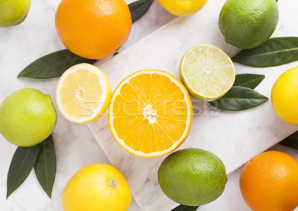Fraîches organique brut oranges citrons marbre Photo stock © DenisMArt