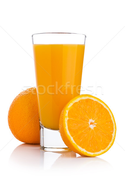 Glass of fresh orange juice with fruit bits Stock photo © DenisMArt