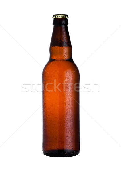 Brown glass beer bottle with black cap with dew Stock photo © DenisMArt