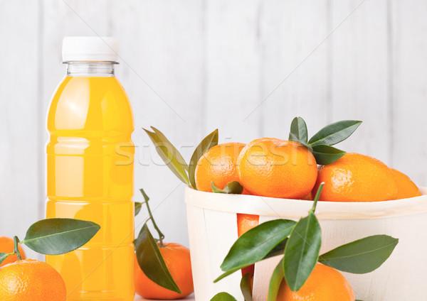 Plastic bottle of fresh mandarin tangerine juice Stock photo © DenisMArt