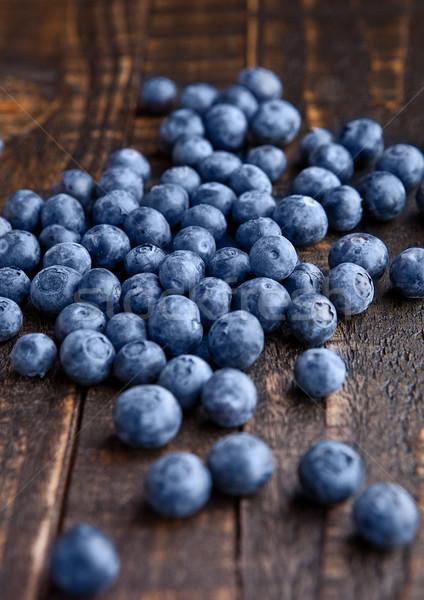 Blueberries on grunge wooden kitchen board Stock photo © DenisMArt