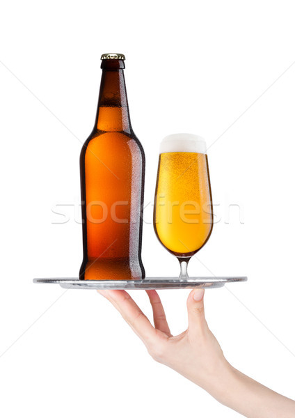 Hand holds tray with lager beer glass and bottle Stock photo © DenisMArt