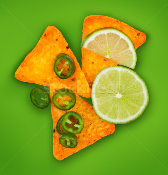 Mexican corn nachos chips with hot pepper and lime Stock photo © DenisMArt