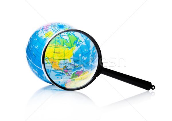 Globe under magnifying glass Amercia and Mexico Stock photo © DenisMArt