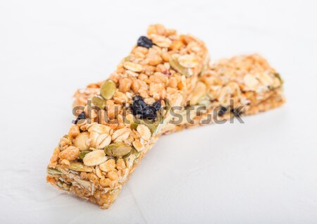 Chocolate protein cereal energy bar on white Stock photo © DenisMArt