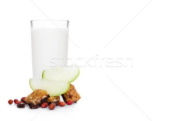 Cereal bar bits apple chocolate and glass of milk Stock photo © DenisMArt