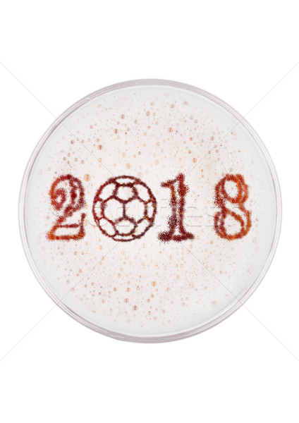 Glass of red ale beer top with football 2018 shape Stock photo © DenisMArt