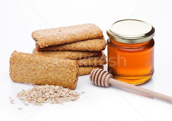 Egészséges bio reggeli gabona kekszek méz Stock fotó © DenisMArt