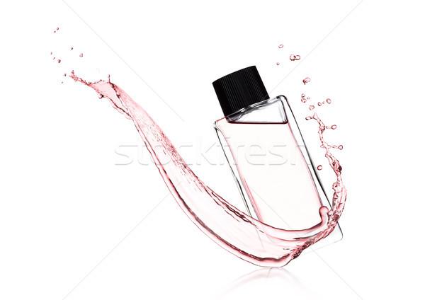 Luxo rosa líquido perfume garrafa Foto stock © DenisMArt