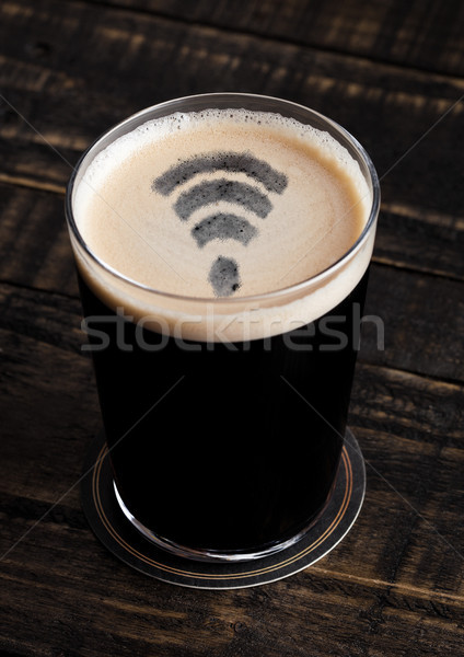 Glass of stout beer top with wi-fi symbol shape Stock photo © DenisMArt