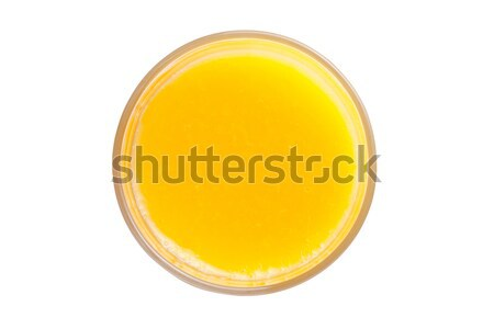 Orange soda drink with ice cube top view Stock photo © DenisMArt